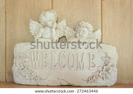 Cupid Welcome Sign - stock photo