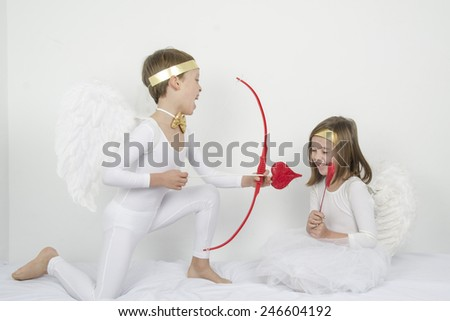 cupid with angel - stock photo