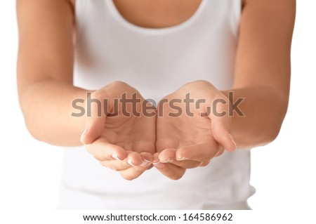 Cupped empty hands over body background. - stock photo