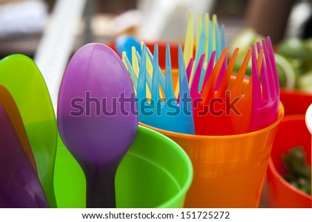 Cups fork  and spoons in different color - stock photo