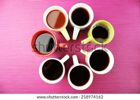 Cups of coffee on color background - stock photo