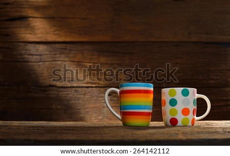 Cups of coffee on old wooden background - stock photo