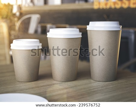 Cups of different sizes on restaurant table - stock photo