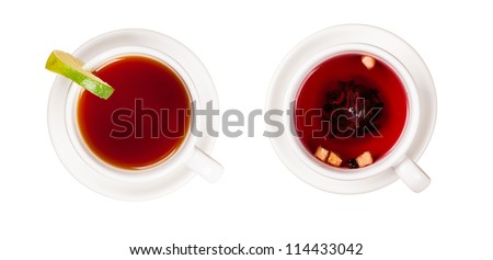Cups of tea shot from top view, isolated on white background - stock photo