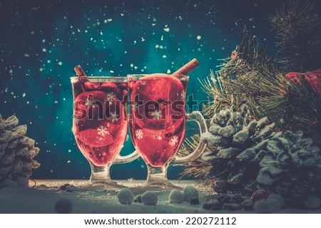 Cups with hot mulled wine in Christmas still life  - stock photo