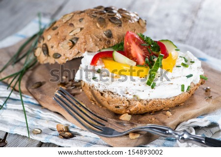Curd and fresh Herbs on a roll - stock photo
