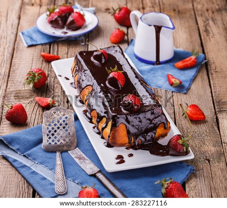 Curd cheese cake with chocolate frosting and strawberries. - stock photo