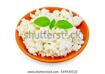Curd in a clay plate with green basil isolated on white background - stock photo