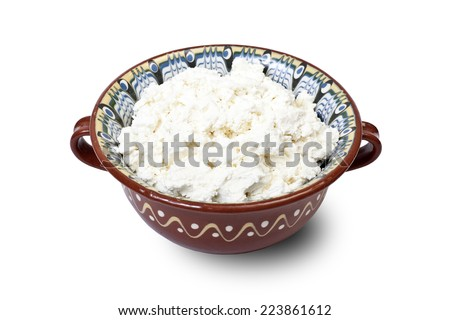 curd in ceramic brown bowl isolated on white background  - stock photo