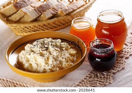 Curd with different fruit jams and bread - stock photo