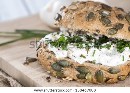 Curd with fresh Herbs on a roll