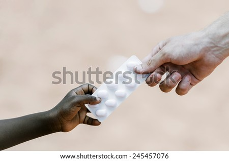 Cure Ebola - White Man Hand Giving Ill Patient Medications  - stock photo