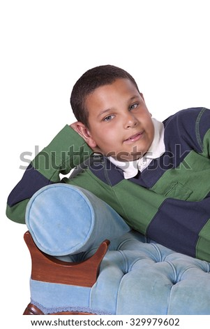 Cure Preteen Boy on the Couch - Isolated Background - stock photo