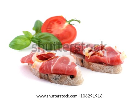 Cured ham iberico tapa, spanish appetizer, on white background isolated - stock photo