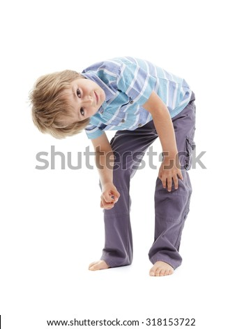 Curious and intrigued boy bending over tilting head and looking up suspiciously - stock photo