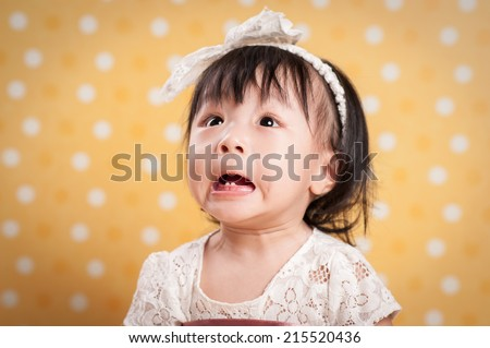 Curious Baby making funny face isolated on white - stock photo