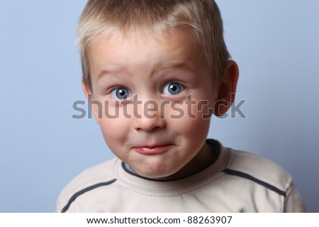 curious boy looking at a camera - stock photo