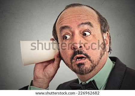 curious businessman listening to conversation. Face expression, reaction, emotion. Privacy concept  - stock photo