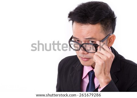 curious businessman looking at you - stock photo