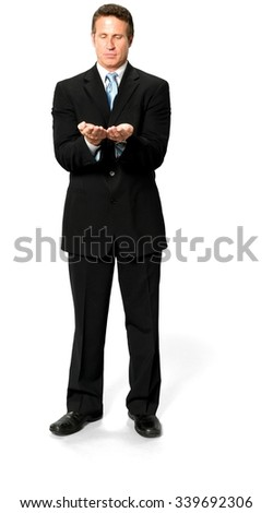 Curious Caucasian man with short black hair in business formal outfit holding invisible object - Isolated - stock photo