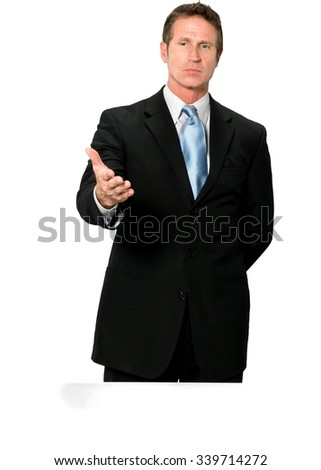 Curious Caucasian man with short black hair in business formal outfit with hands behind back - Isolated - stock photo