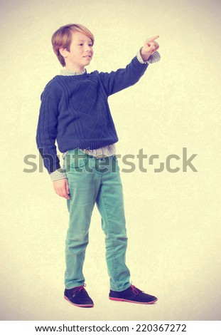 Curious child pointing - stock photo