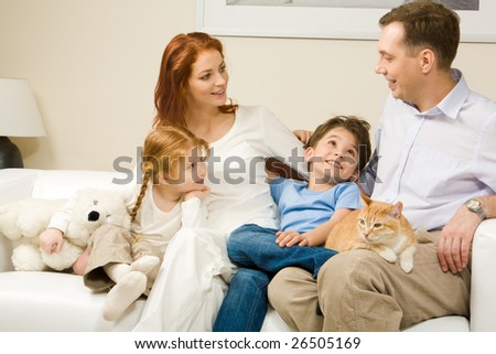 Curious children and woman listening attentively to man telling an interesting story - stock photo
