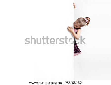 Curious girl peeks out from behind the banner - stock photo