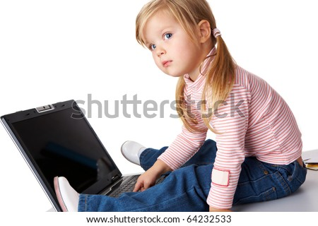 Curious girl sitting in front of laptop and looking aside - stock photo