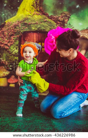 curious little baby  glad his  mother - stock photo