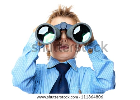 Curious little boy is looking through binoculars. Isolated over white background. - stock photo