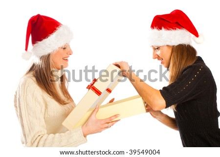 Curious lovely girl opening her Christmas present - stock photo