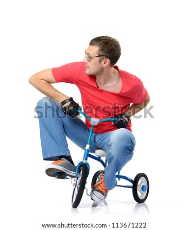 Curious man in glasses on a children's bicycle on white background, isolated path included - stock photo