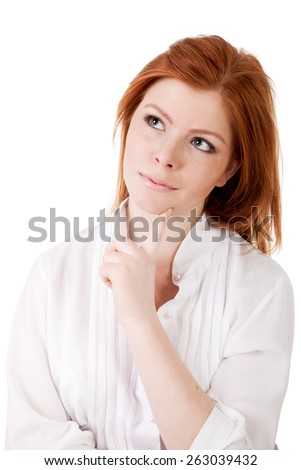 Curious woman thinking finger on chin - stock photo