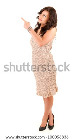 curious young woman pointing up, full length, white background