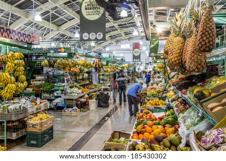 CURITIBA, BRAZIL - MARCH 30: Interior architecture of the Municipal Market in Curitiba, Parana, Brazil with locals shopping for groceries on March 30, 2014. - stock photo