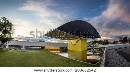 CURITIBA, BRAZIL - MARCH 30: Panorama of the Oscar Niemeyer Museum in Curitiba, PR, Brazil showcasing its eye-shapper sculpture placed in front of its main entrance at sunset on March 30, 2014. - stock photo