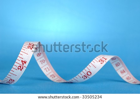curl measuring tape - stock photo