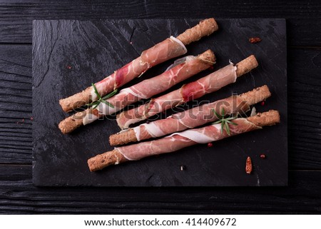 Curled Slices of Delicious Prosciutto with spice  Italian and Mediterranean cuisine  - stock photo