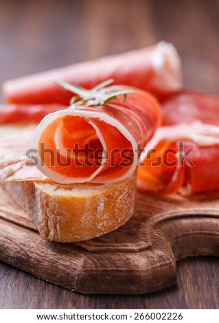 Curled Slices of  Prosciutto .selective focus - stock photo