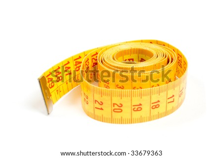 Curled yellow measuring tape on white background - stock photo