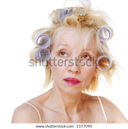 Curler Woman. A blonde woman with lavender curlers in her hair.  Bad hair day. - stock photo