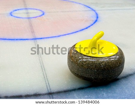 curling game. stone on the Ice. - stock photo