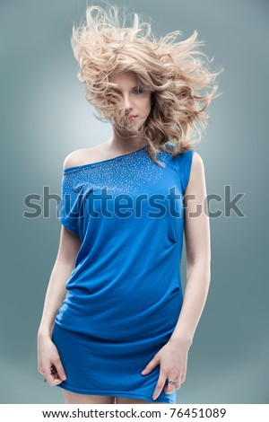 curly blonde woman blue dress