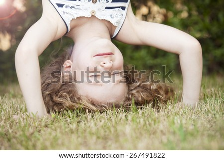 curly girl upside down - stock photo