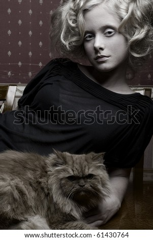 curly girl with cat - stock photo