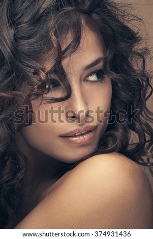 curly hair beauty woman portrait, studio shot, closeup - stock photo