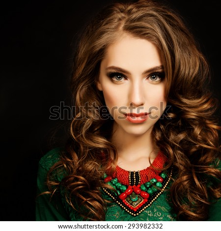 Curly Hair Girl. Beautiful Fashion Model Woman. Curly Coloring Hairstyle and Makeup - stock photo