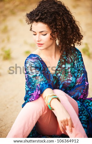 curly hair smiling woman portrait outdoor summer day - stock photo