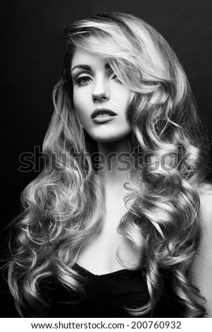 Curly hair woman face black and white beauty portrait - stock photo